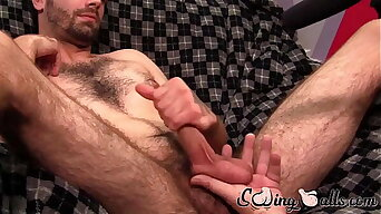 Amateur jerks off while his balls are touched by camera man